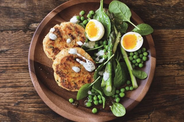 Salmon and cauliflower fishcakes with pea, spinach and asparagus salad